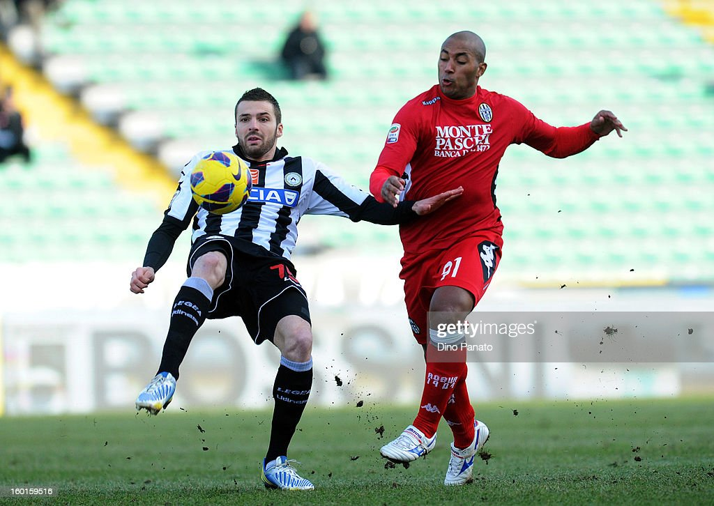 Thomas Hertaux (L) of Udinese Calcio competes with Rerginaldo Ferreira Da Silva of AC Siena during the Serie A match between Udinese Calcio and AC Siena at Stadio Friuli on January 27, 2013 in Udine, Italy.