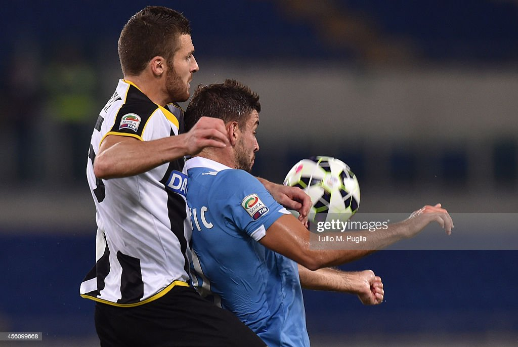 Thomas Heurtaux (L) of Udinese and Filip Djordjevic of Lazio compete for the ball during the Serie A match between SS Lazio and Udinese Calcio at Stadio Olimpico on September 25, 2014 in Rome, Italy.