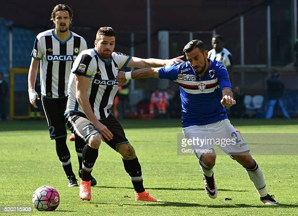 Thomas Heurtaux of Udinese Calcio and Fabio Quagliarella of UC Sampdoria compete for the ball during the Serie A match between UC Sampdoria and...