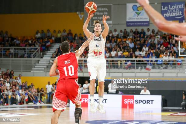 Thomas Heurtel of France is shooting the basket against RokoLeni Ukic of Croatia during the international friendly game between France and Croatia at...