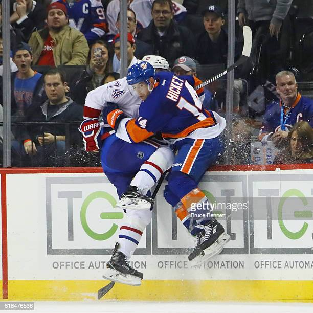 Thomas Hickey of the New York Islanders checks Alexei Emelin of the Montreal Canadiens during the third period at the Barclays Center on October 26...