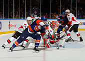 Thomas Hickey of the New York Islanders sends the puck in front of the net and scroes the winning goal at 306 of overtime against Craig Anderson of...