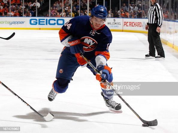 Thomas Hickey of the New York Islanders skates against the Philadelphia Flyers at Nassau Veterans Memorial Coliseum on April 9 2013 in Uniondale New...