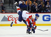 Thomas Hickey of the New York Islanders takes a third period penalty for interference on Reilly Smith of the Florida Panthers in Game Six of the...