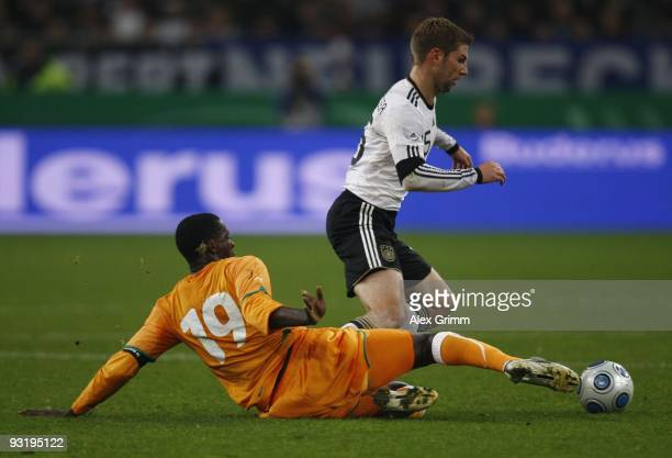 Thomas Hitzlsperger of Germany is tackled by Yaya Toure of Ivory Coast during the international friendly match between Germany and Ivory Coast at the...