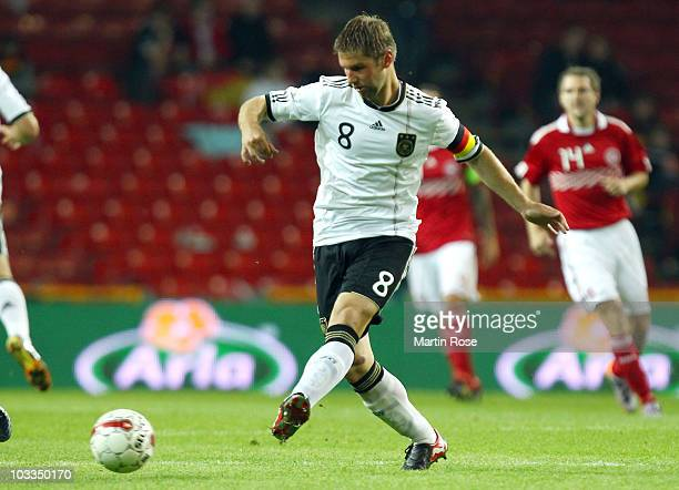 Thomas Hitzlsperger of Germany runs with the ball during the International Friendly match between Denmark and Germany at Parken stadium on August 11...
