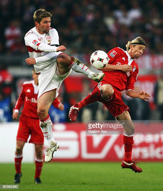 Thomas Hitzlsperger of Stuttgart and Anatoliy Tymoshchuk of Bayern battle for the ball during the Bundesliga match between VfB Stuttgart and FC...