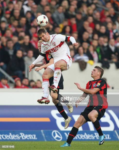 Thomas Hitzlsperger of Stuttgart battles for the ball with Sascha Bigalke of Berlin and his team mate Lukasz Piszczek during the Bundesliga match...