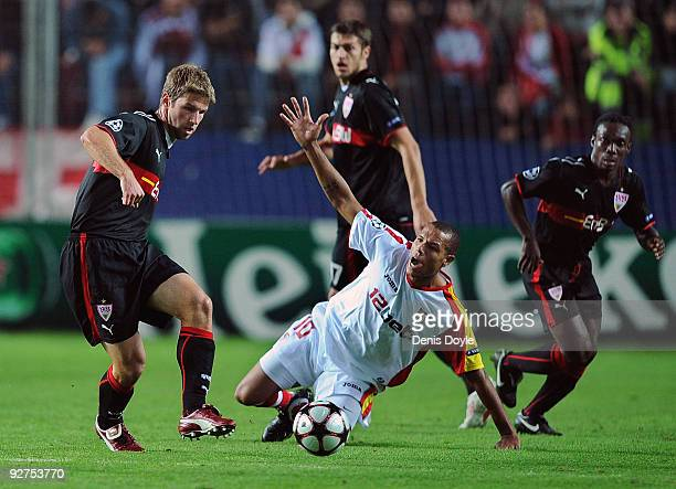 Thomas Hitzlsperger of VfB Stuttgart tackles Luis Fabiano of Sevilla during the UEFA Champions League Group G match between Sevilla and VfB Stuttgart...