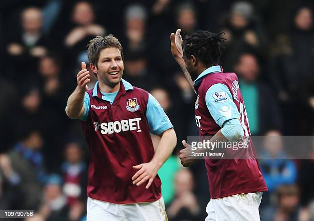 Thomas Hitzlsperger of West Ham United celebrates with team mate Frederic Piquionne after scoring his sides third goal during the Barclays Premier...