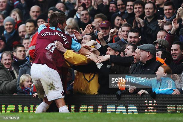 Thomas Hitzlsperger of West Ham United celebrates with the crowd after scoring his sides third goal during the Barclays Premier League match between...