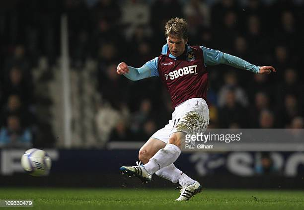 Thomas Hitzlsperger of West Ham United shoots to score the opening goal during the FA Cup sponsored by EON 5th Round match between West Ham United...