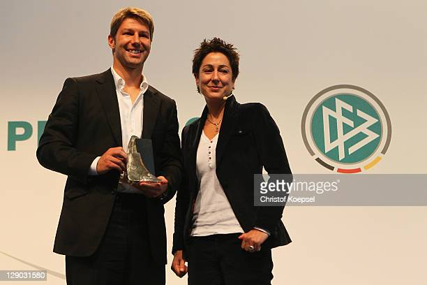 Thomas Hitzlsperger presents the honorary prize of the Julius Hirsch Award with moderator Dunja Hayali during the Julius Hirsch Award 2011 at the...