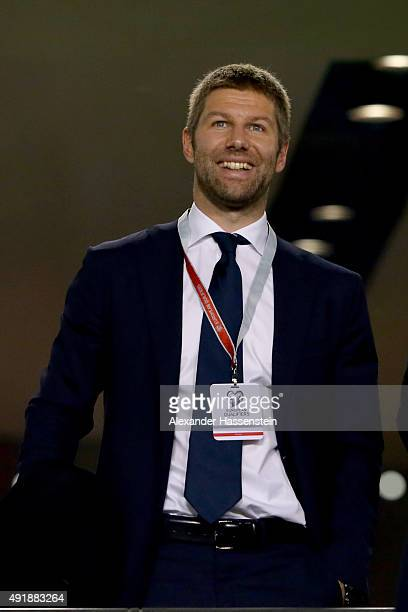 Thomas Hitzlsperger smiles prior to the UEFA EURO 2016 Qualifier group D match between Republic of Ireland and Germany at the Aviva Stadium on...