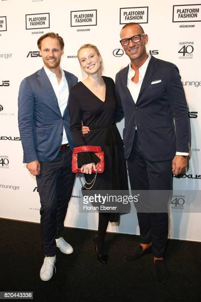 Thomas Hoehn Kim Hnizdo and Andreas Rebbelmund attend the Breuninger show during Platform Fashion July 2017 at Areal Boehler on July 21 2017 in...