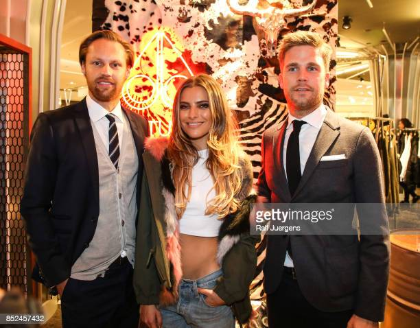 Thomas Hoehn Sophia Thomalla and David Zimmermann pose during the store event 'Moose Knuckles at Breuninger The Future Tribe Party' on September 23...