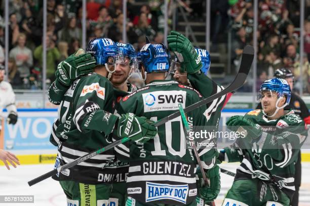 Thomas Holzmann of Augsburger Panther Gabe Guentzel of Augsburger Panther Arvids Rekis of Augsburger Panther celebrate a goal during the DEL match...