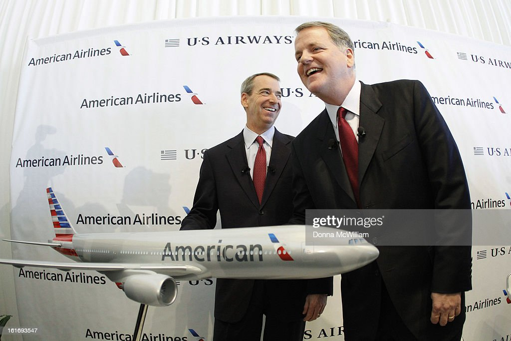 Thomas Horton (L) Chairman, President and Chief Executive Officer of American Airlines, and Doug Parker, Chairman and CEO of US Airways pose with a model triple seven airraft during a news conference to announce the merger of the two airlinesFebruary 14, 2013 in Dallas Texas. US Airways and American Airlines have agreed to an $11 billion merger, creating the largest airline in the world. The airline will be called American Airlines and be headed by US Airways CEO Doug Parker. (Photo by Donna McWilliam/Getty Images