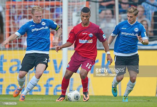 Thomas Huebener and Tom Schuetz of Bielefeld tackle Elias Kachunga of Paderborn during the Second Bundesliga match between Arminia Bielefeld and SC...