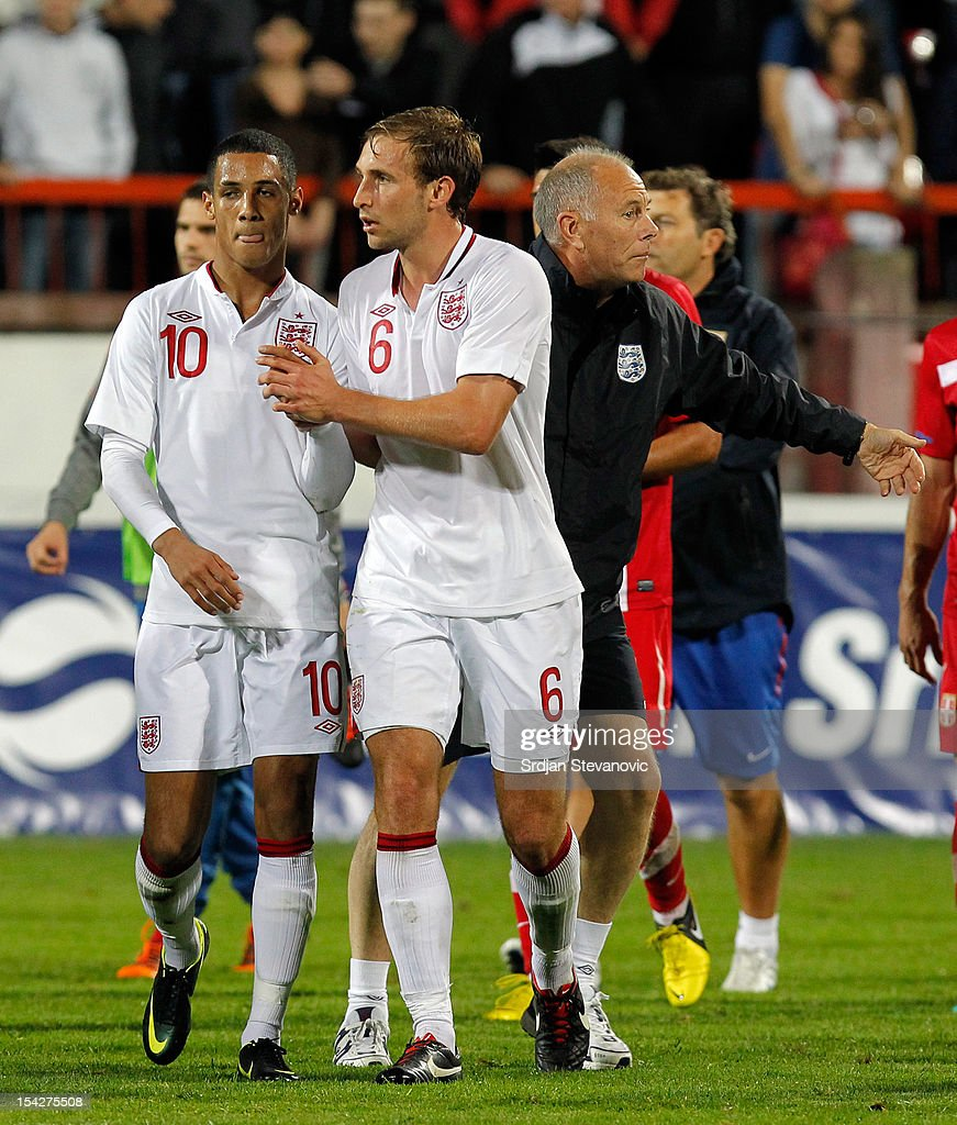 Thomas Ince and Craig Dawson of England walk off after the Under 21 European Championship Play Off second leg match between Serbia U21 and England U21 at Stadium Mladost on October 16, 2012 in Krusevac, Serbia.
