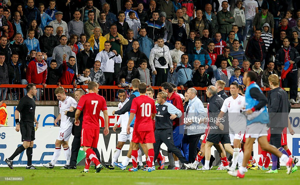 Thomas Ince and Tom Lees of England are led away during a scuffle after the Under 21 European Championship Play Off second leg match between Serbia U21 and England U21 at Stadium Mladost on October 16, 2012 in Krusevac, Serbia.