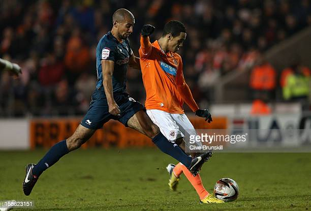 Thomas Ince of Blackpool attempts to shoot watched by Karl Henry of Wolverhampton Wanderers during the npower Championship match between Blackpool...