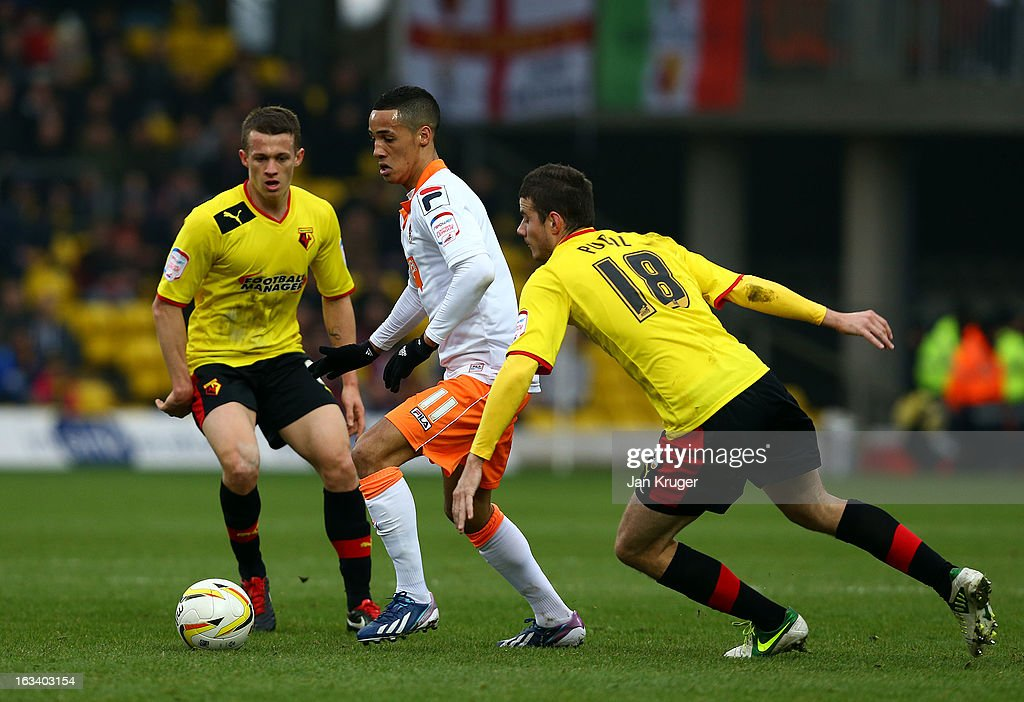 Thomas Ince of Blackpool shields the ball from Daniel Pudil of Watford during the npower Champions match between Watford and Blackpool at Vicarage Road on March 9, 2013 in Watford, England.