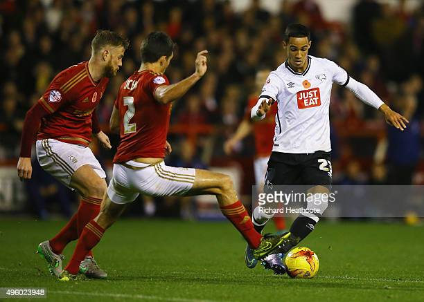 Thomas Ince of Derby County takes on Eric Lichaj and Matt Mills of Nottingham Forest during the Sky Bet Championship match between Nottingham Forest...