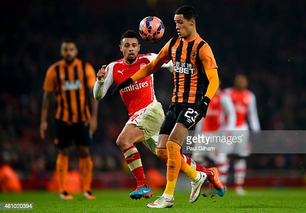 Thomas Ince of Hull City controls the ball under pressure from Francis Coquelin of Arsenal during the FA Cup Third Round match between Arsenal and...
