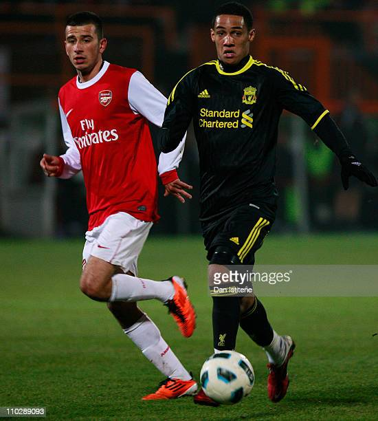 Thomas Ince of Liverpool in action against Oguzhan Ozyakup of Arsenal during the Barclays Premier Reserve League match between Arsenal and Liverpool...