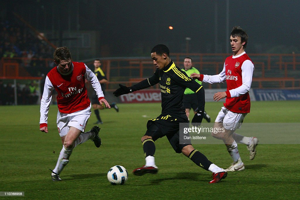 Thomas Ince of Liverpool in action against Sead Hajrovic and Josh Rees of Arsenal during the Barclays Premier Reserve League match between Arsenal...
