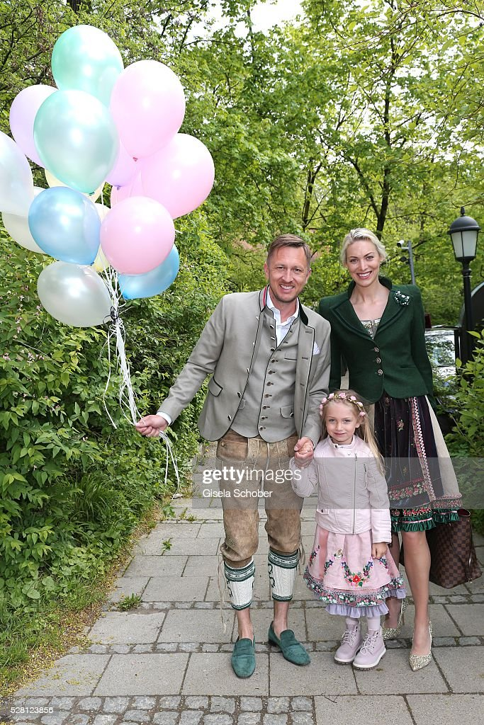 Thomas Isermann and his wife Maria Isermann and their daughter Lilly during the wedding of Sophie Wepper and David Meister at 'Seehaus' on May 4, 2016 in Munich, Germany.