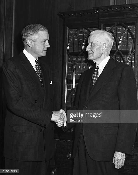 Thomas J Watson Jr receives congratulations from his father Thomas J Watson Sr after being elected Chief Executive Officer of International Business...