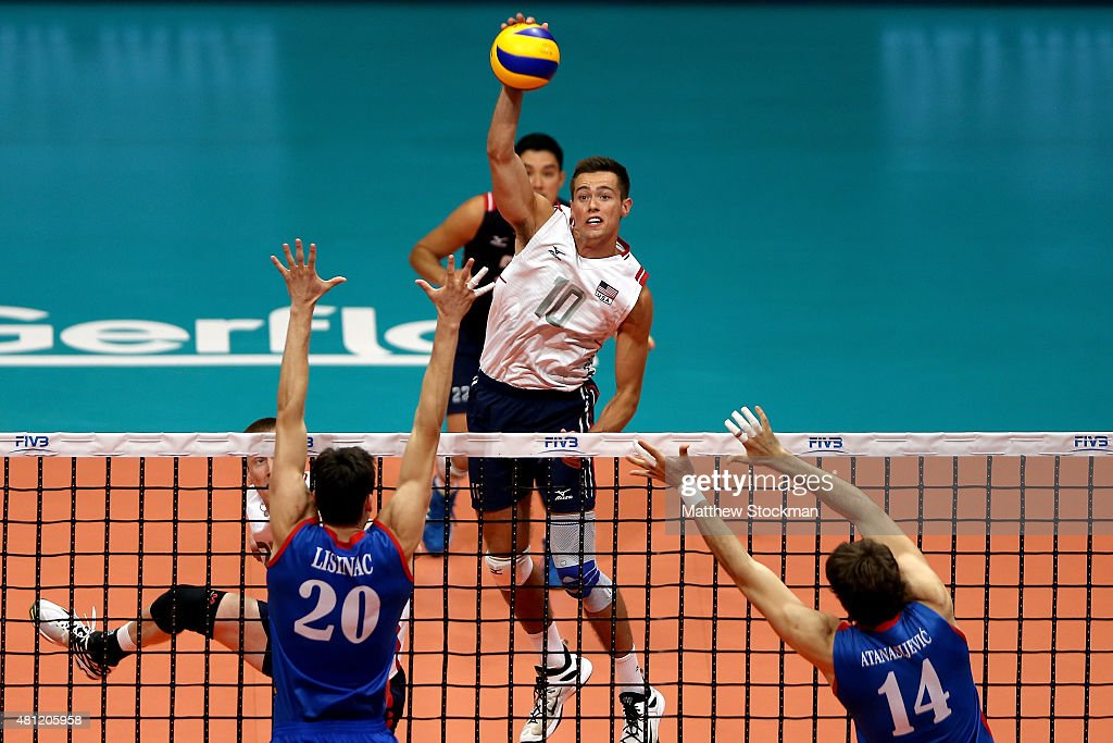 Thomas Jaeschke of the United States spikes the ball against (L-R) Srecko Lisinac and Aleksandar Atanasijevic of Serbia during the FIVB World League Group 1 Finals semi-final match between the United States and Serbia at Maracanazinho on July 18, 2015 in Rio de Janeiro, Brazil.