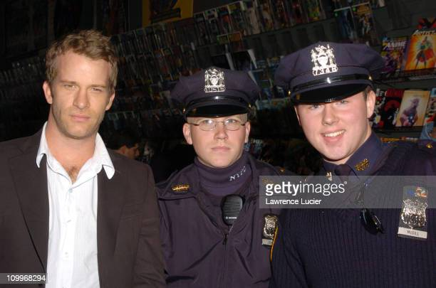 Thomas Jane and NYC Police Officers during Thomas Jane In Store Appearance to Promote The Punisher April 15 2004 at Midtown Comics in New York City...