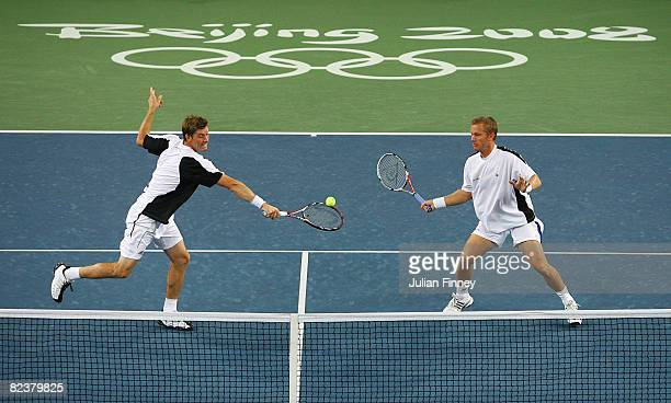 Thomas Johansson and Simon Aspelin of Sweden take on Roger Federer and Stanislas Wawrinka of Switzerland during the men's doubles gold medal tennis...
