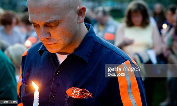 Thomas Jones a local coal miner participates in a candelight vigil in Whitesville West Virginia April 7 for the 25 miners that were killed in an...