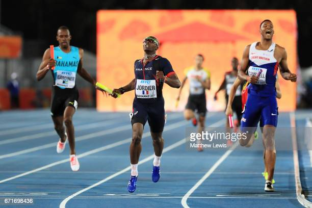 Thomas Jordier of team France and Theo Campbell of team Great Britain cross the finishline in heat one of the Men's 4 x 400 Meters Relay during the...