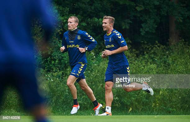 Thomas Kahlenberg and Martin Albrechtsen of Brondby IF warming up during the Brondby IF training session at Brondby Stadion on June 14 2016 in...
