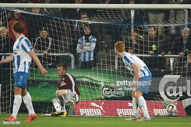 Thomas Kahlenberg of Brondby IF scores the 31 goal against Goalkeeper Maksym Koval of OB Odense during the Danish Alka Superliga match between OB...