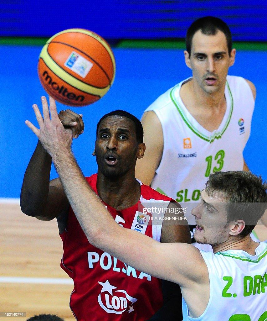Thomas Kelati of Poland vies with Zoran Dragic and Domen Lorbek of Slovenia during the group C qualification match to EuroBasket 2013 Championships...