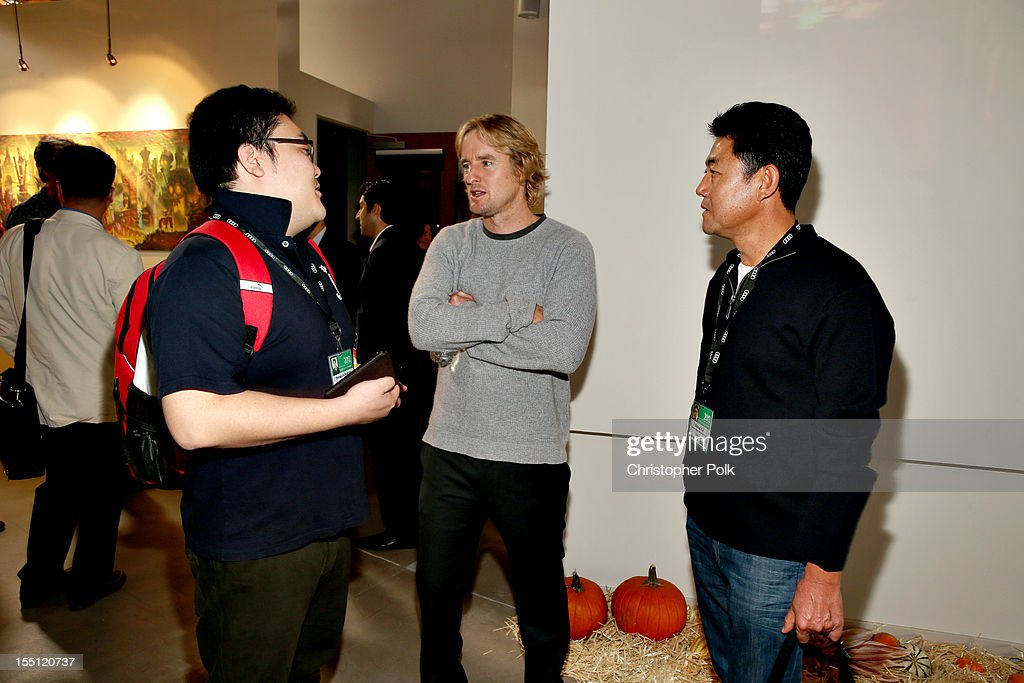 Thomas Kim of Pure Features, Korea; <a gi-track='captionPersonalityLinkClicked' href=/galleries/search?phrase=Owen+Wilson&family=editorial&specificpeople=202027 ng-click='$event.stopPropagation()'>Owen Wilson</a>, Star of 'Turkeys' (Voice Talent); and Michael Kim, Mars Entertainment, Korea at RealFX on November 1, 2012 in Santa Monica, California.