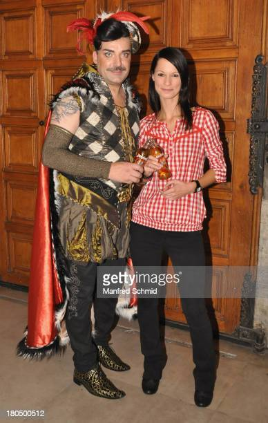 Thomas Klein and Christina Stuermer pose for a photograph during the Trachtenpaerchenball 2013 at Cityhall Vienna on September 13 2013 in Vienna...
