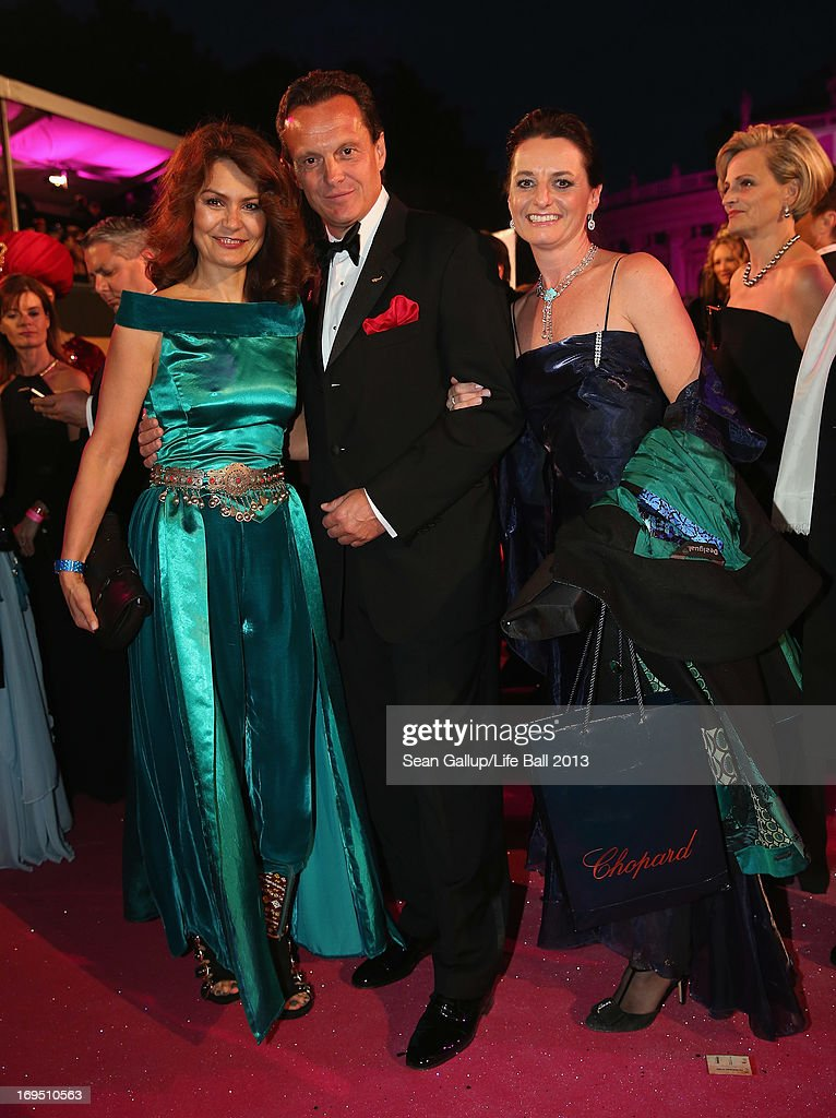 Thomas Koblmueller (C), Managing Director of Chopard in Austria, and his colleagues Djahana Astanakulova (L) and Silke Sautter arrive on the Magenta Carpet at the 2013 Life Ball at City Hall on May 25, 2013 in Vienna, Austria.