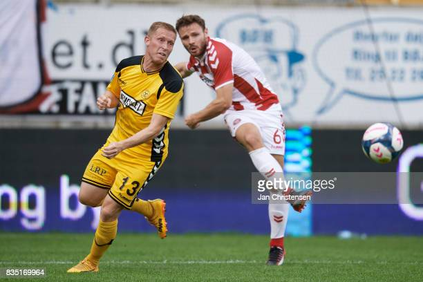 Thomas Kortegaard of AC Horsens and Kristoffer Pallesen of AaB Aalborg compete for the ball during the Danish Alka Superliga match between AC Horsens...