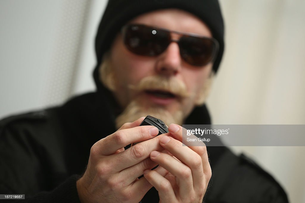 Thomas Kuban, a journalist who for over a decade filmed neo-Nazi concerts and other right-wing events, wears a disguise as he explains the use of one of the miniature cameras he used while speaking to the Foreign Journalists' Association on November 30, 2012 in Berlin, Germany. Thomas, Kuban, which is an alias, produced a documentary film and also recently completed a book from his experiences titled 'Blut Muss Fliessen, Undercover Unter Nazis' ('Blood Must Flow, Undercover Under Nazis'). Kuban said the concerts and the sale of music CDs are the neo-Nazi scene's most important instrument for recruiting new followers and for generating funding. Kuban avoids revealing his true identity because he fears reprisals from neo-Nazis.