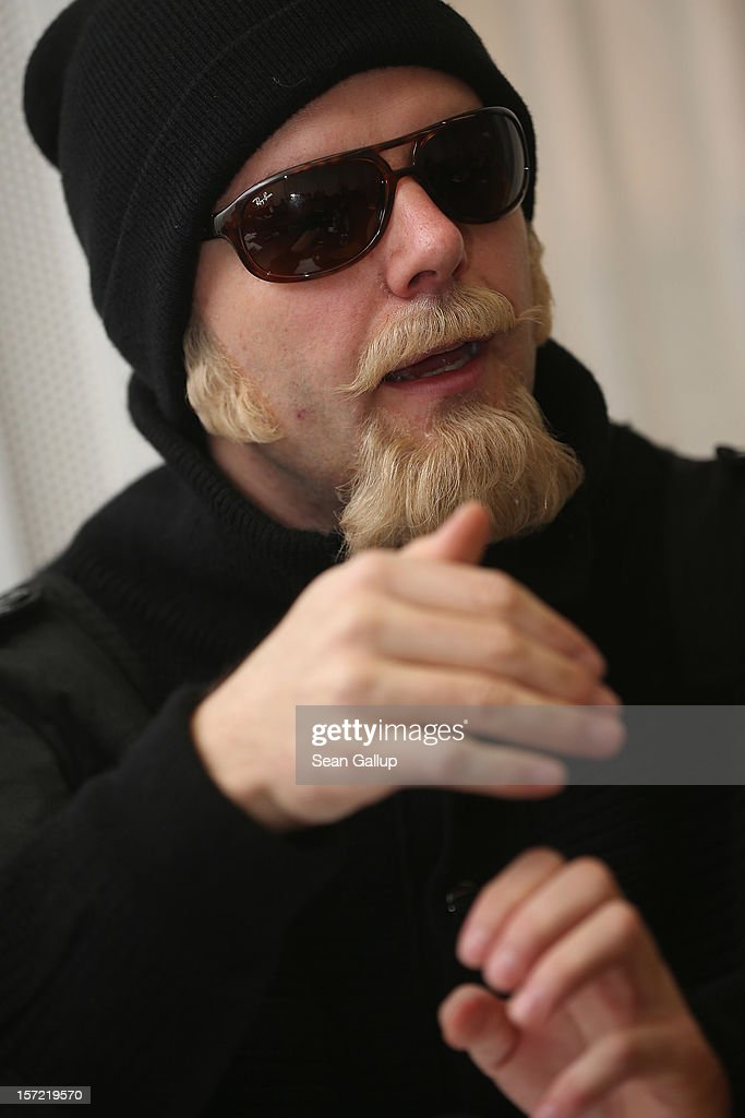 Thomas Kuban, a journalist who for over a decade filmed neo-Nazi concerts and other right-wing events, wears a disguise as he speaks to the Foreign Journalists' Association on November 30, 2012 in Berlin, Germany. Thomas, Kuban, which is an alias, produced a documentary film and also recently completed a book from his experiences titled 'Blut Muss Fliessen, Undercover Unter Nazis' ('Blood Must Flow, Undercover Under Nazis'). Kuban said the concerts and the sale of music CDs are the neo-Nazi scene's most important instrument for recruiting new followers and for generating funding. Kuban avoids revealing his true identity because he fears reprisals from neo-Nazis.