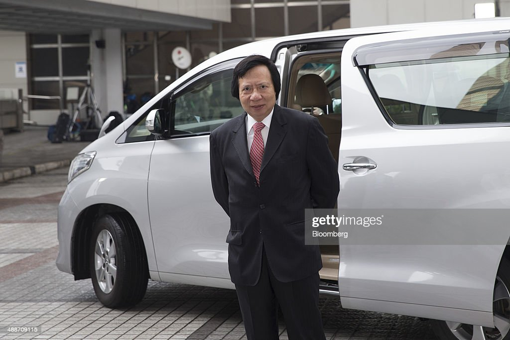 Thomas Kwok, co-chairman of Sun Hung Kai Properties Ltd., arrives at the High Court in Hong Kong, China, on Thursday, May 8, 2014. Thomas and Raymond Kwok, the billionaire brothers running Hong Kongs second-largest developer, are set to go on trial today for bribing Rafael Hui, the Chinese citys former No. 2 official. All three men have pleaded not guilty and denied all charges. Photographer: Brent Lewin/Bloomberg via Getty Images