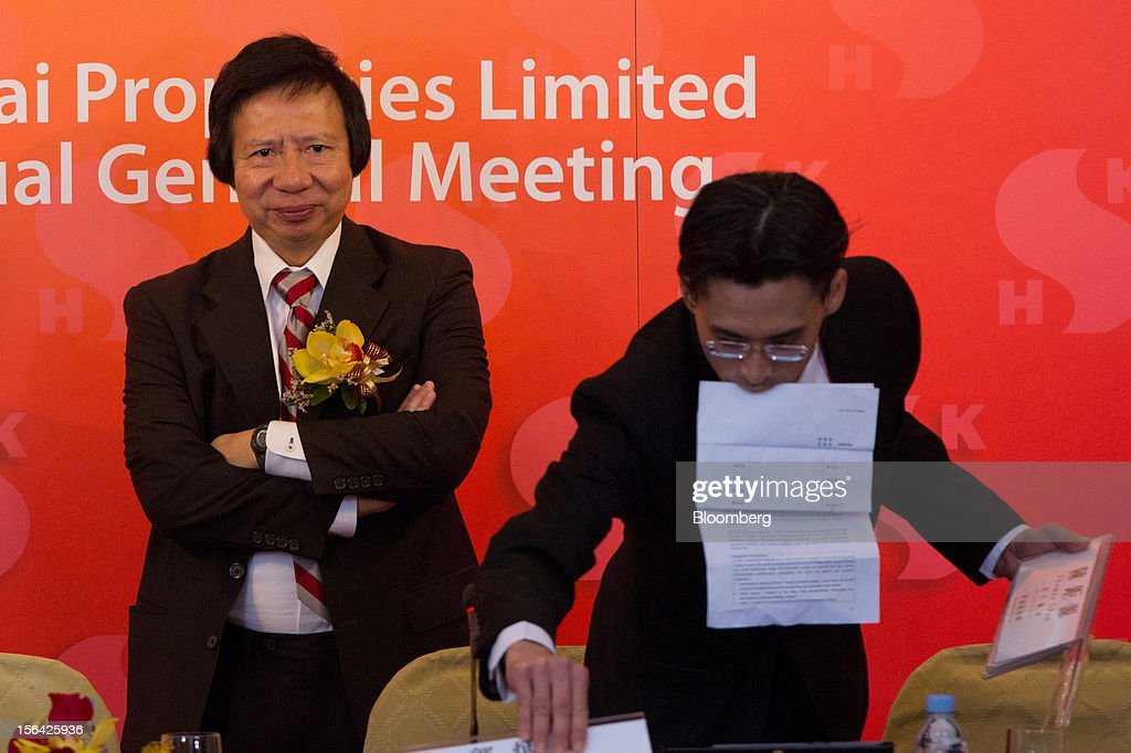Thomas Kwok, co-chairman of Sun Hung Kai Properties Ltd., left, stands at the end of a news conference in Hong Kong, China, on Thursday, Nov. 15, 2012. Sun Hung Kai will continue buying land in Hong Kong, says Thomas Kwok. Photographer: Lam Yik Fei/Bloomberg via Getty Images