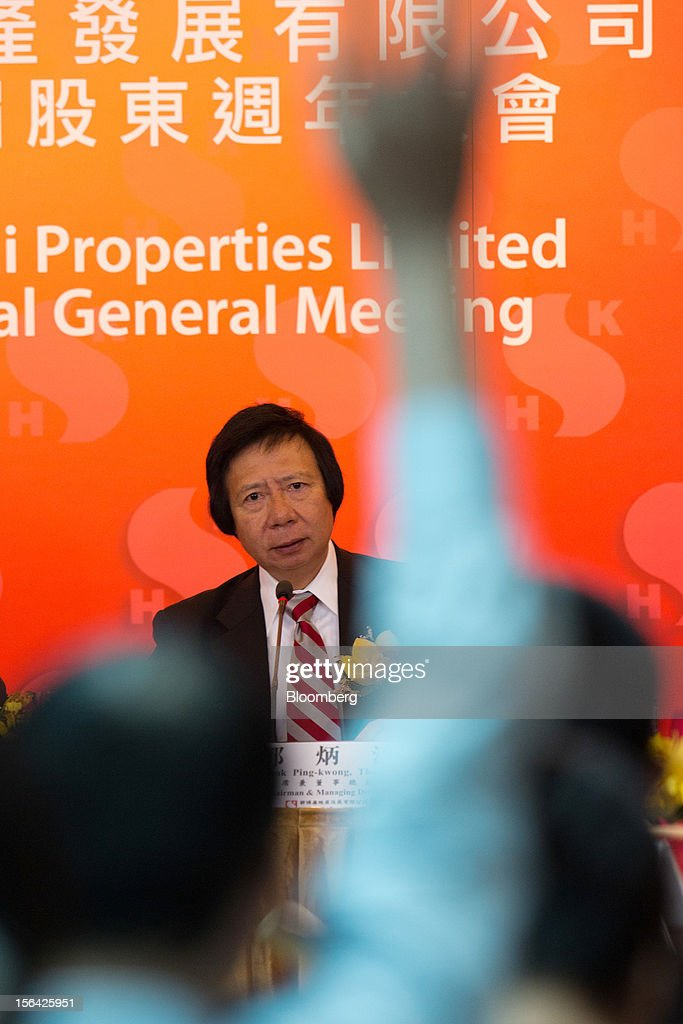 Thomas Kwok, co-chairman of Sun Hung Kai Properties Ltd., looks on as a member of the media raises his hand at a news conference in Hong Kong, China, on Thursday, Nov. 15, 2012. Sun Hung Kai will continue buying land in Hong Kong, says Thomas Kwok. Photographer: Lam Yik Fei/Bloomberg via Getty Images